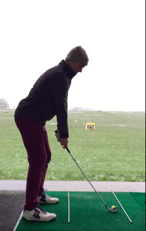 How to draw a golf ball: Shows new posture, with less knee flex and better weight distribution.