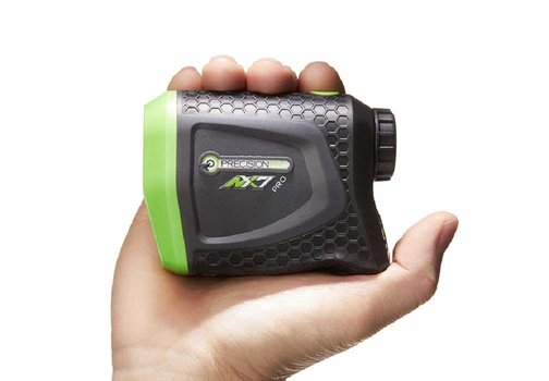 Precision Pro Golf NX7 Pro best golf range finder review. Showing the device being held within a power grip of the hand.