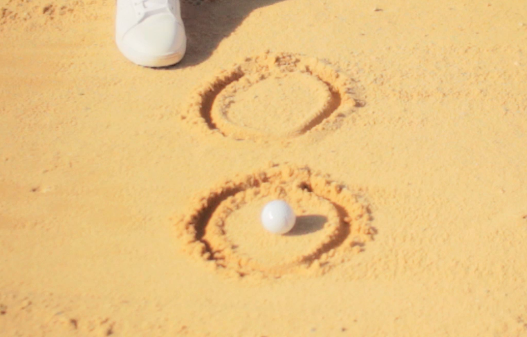 how to hit a bunker shot - throw the circle of sand to your target.