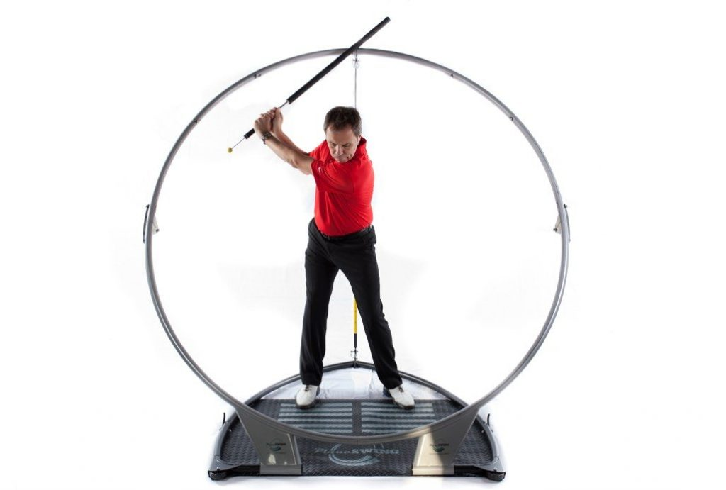 PlaneSwing Trainer with a golfer in the backswing position. These training aids are adjustable to your swing arc