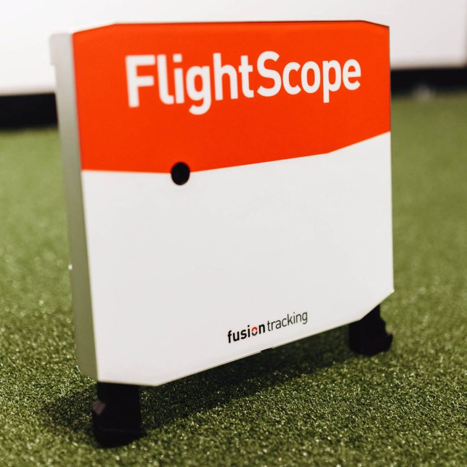 Flightscope X3 launch monitor placed behind the golf ball