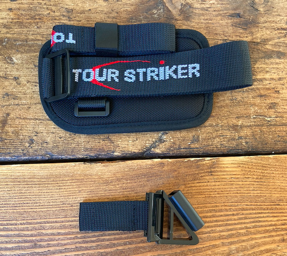 unboxing the impact strap with wrist strap, club strap and attachment.