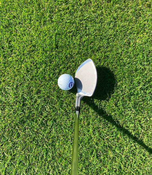 Cutter Golf wedge from POV behind golf ball