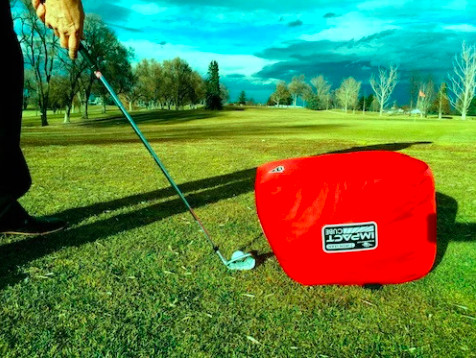 EyeLine Impact Cube placed outside the golf ball during practice drill